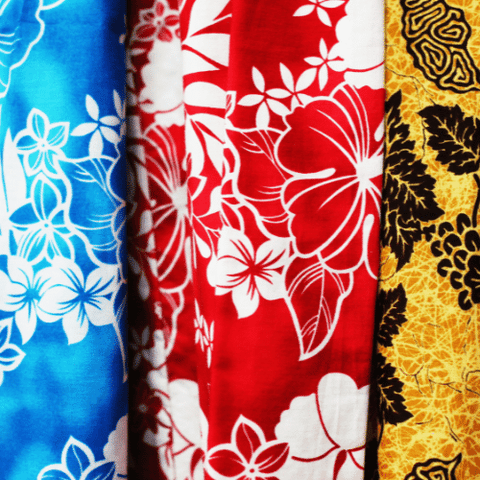 3 fabrics with similar floral designs but in different colours (blue, red and yellow)
