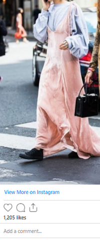 Gilda Ambrosio wearing a pink oversized maxi with a blue shirt underneath whilst crossing the road