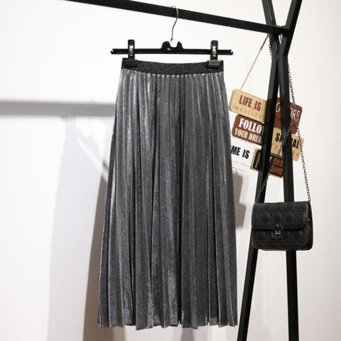 silver coloured skirt hanging on a clothing rail