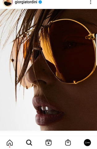 Closeup of a womans face wearing sunglasses