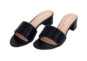 3/4 view of a pair of heeled faux leather sandals