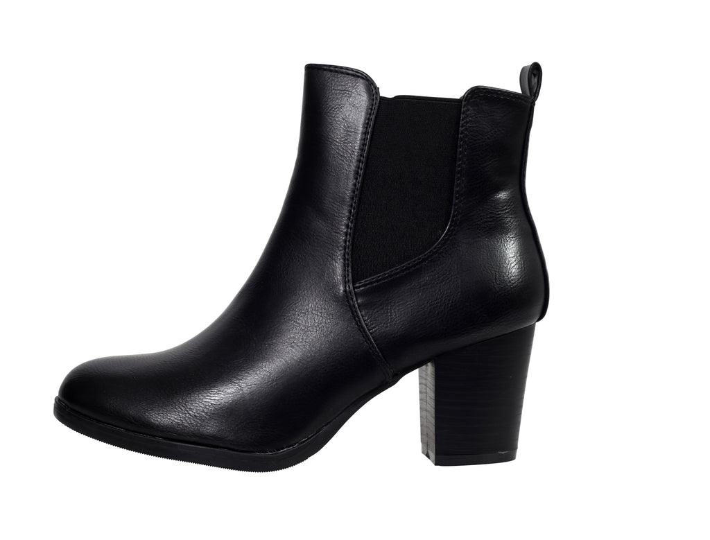Side view of a faux leather ankle boot facing left
