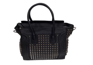 Front view of a black leather handbag with a studded design