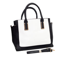 3/4 view of a white and black tote handbag and its spare strap