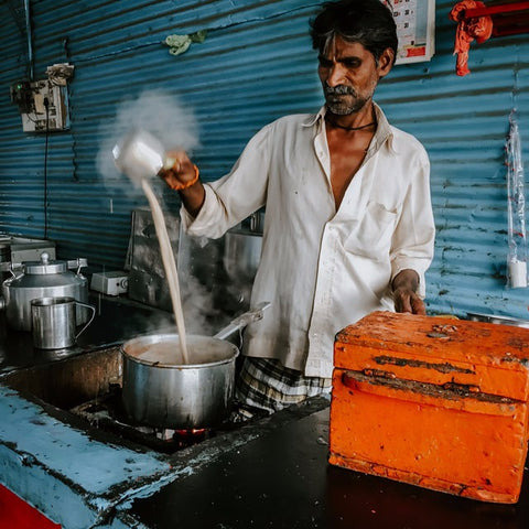 Chai wallah in India, preparation of chai latte