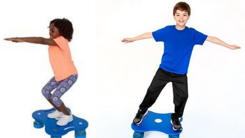Children on KidsFit balance boards in classroom
