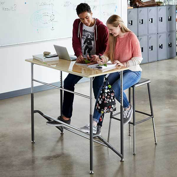 Teens using Stand2Learn Desk for Two 5-12 VARIDESK Education in classroom from Active Goods Canada
