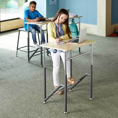 Girl using Stand2Learn Desk K-5 VARIDESK Education in classroom from Active Goods Canada