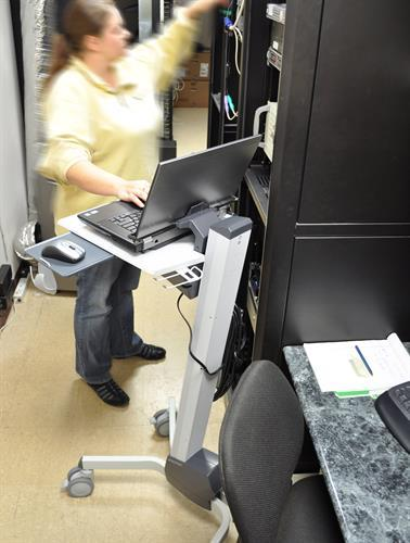 Woman using mobile laptop cart while working from Active Goods Canada