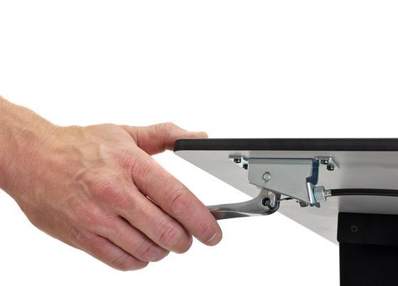 Hand adjusting lever on mobile desk surface. Fitneff Canada