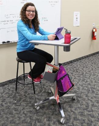 Ergotron LearnFit® Sit-Stand Desk (Tall) from Fitneff, in use with accessories