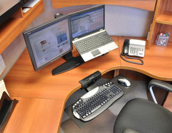 Computer monitor on desk with keyboard tray attached from Active Goods Canada