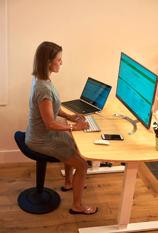 CorePerch Active Stool sitting at office desk by Active Goods Canada