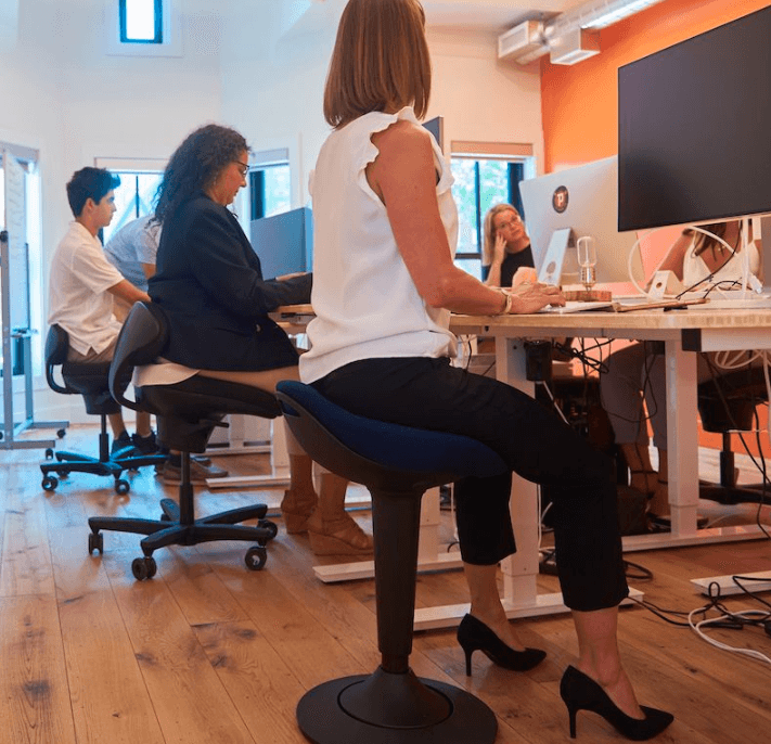 CorePerch Active Stool sitting down while at office desk by Active Goods Canada