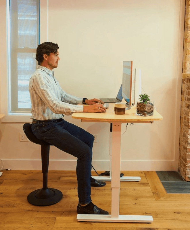 CorePerch Active Stool sitting down at office desk by Active Goods Canada