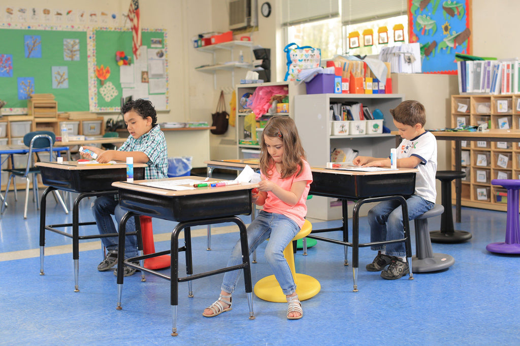 "Children using Kore Pre-School Wobble Chair 12"" in classroom from Active Goods Canada"