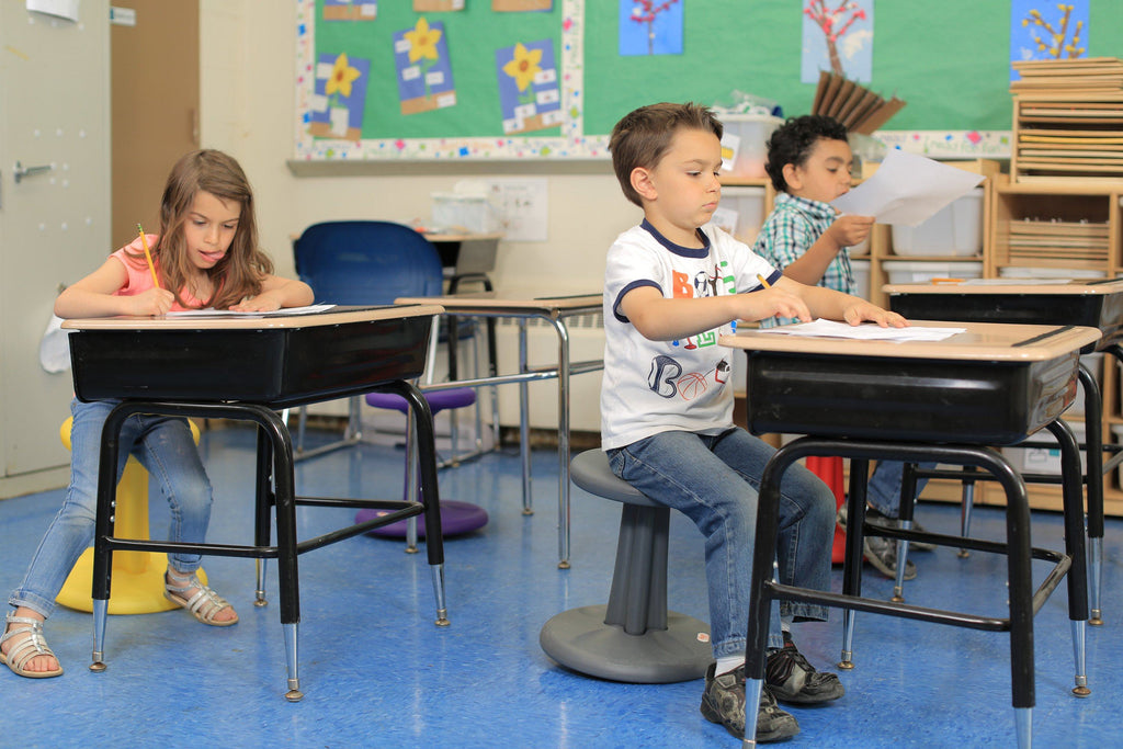 "Kids using Kore Kids Wobble Chair 14"" in classroom from Active Goods Canada"