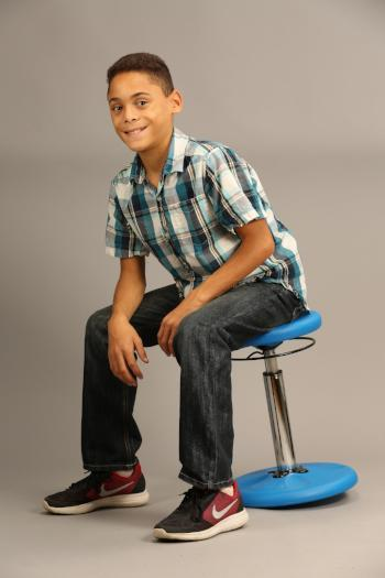 Boy using Kore Kids Height-Adjustable Wobble Chair from Active Goods Canada