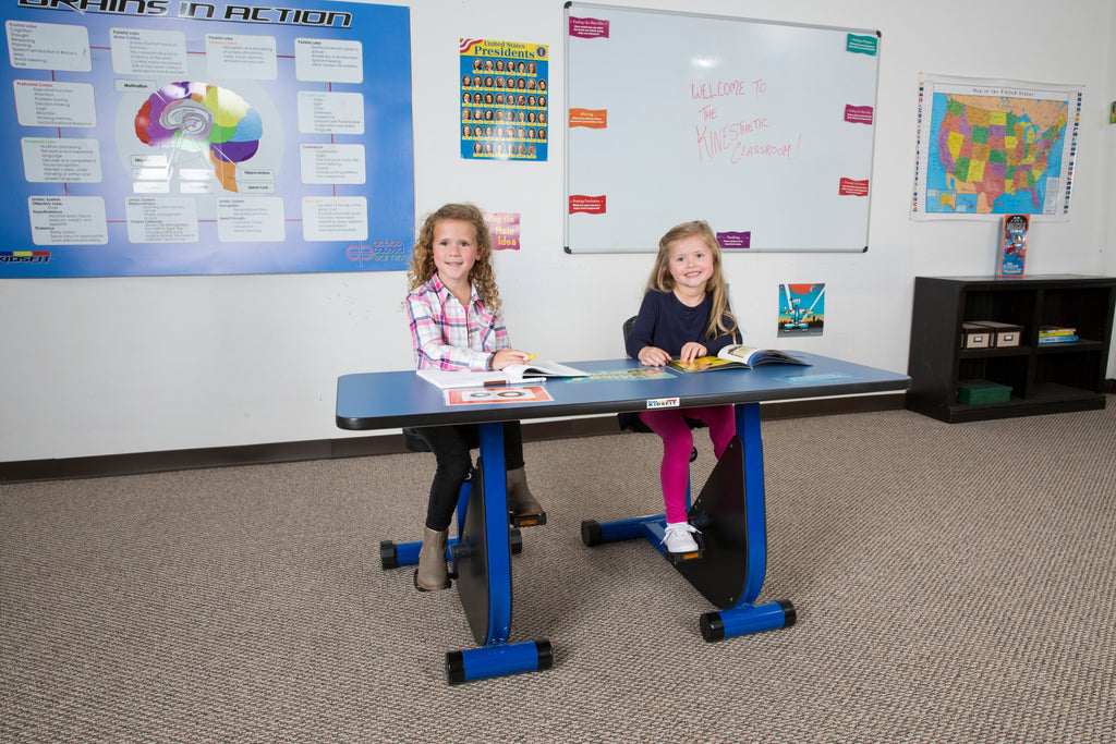Girls using KidsFit Pedal Desk in active classroom