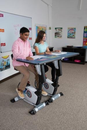 Kids using KidsFit Double Pedal Desk from Active Goods Canada - moving classroom