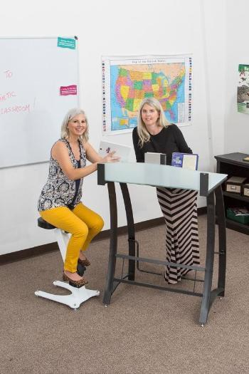 Adults using KidsFit Pedal Stool with standing desk from Active Goods Canada