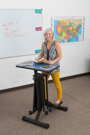 Woman using KidsFit Strider Desk from Active Goods Canada - active classroom