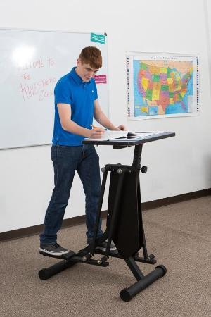 Boy using KidsFit Strider Desk from Active Goods Canada- ergonomic classroom