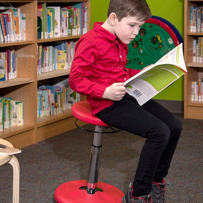 Kore Kids Adjustable Standard Wobble Chair for Active Sitting while reading from Active Goods Canada