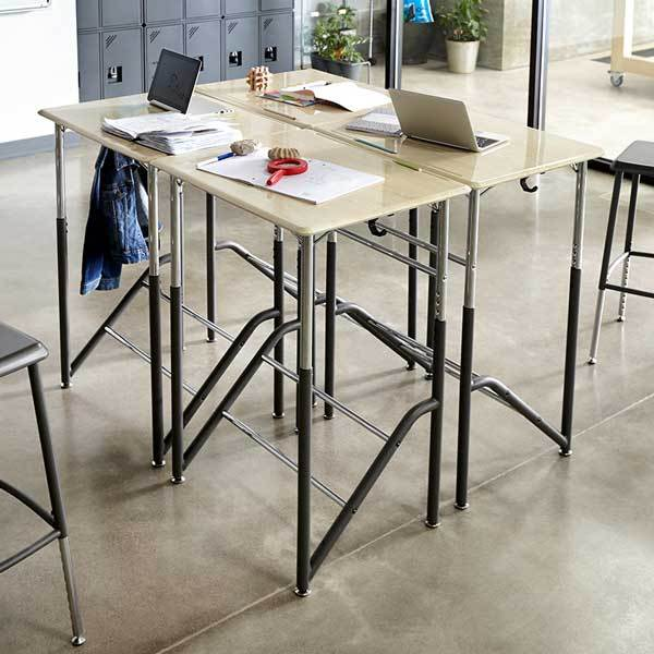 Group of four Stand2Learn Desks 5-12 VARIDESK Education in classroom