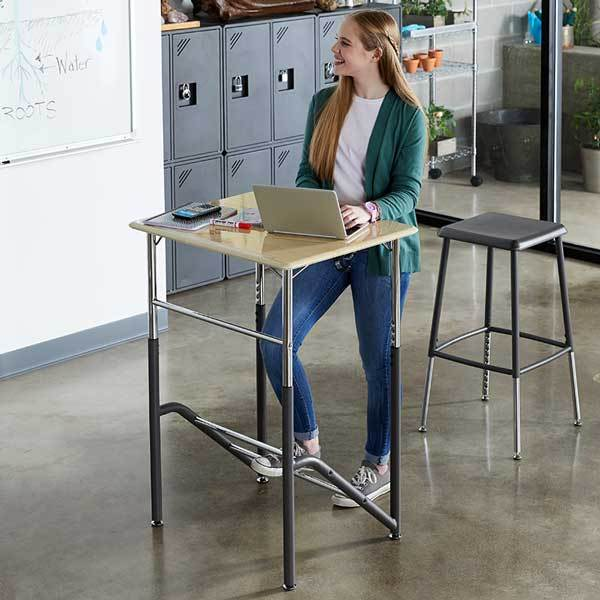 Girl using Stand2Learn Desk 5-12 VARIDESK Education in classroom from Active Goods Canada