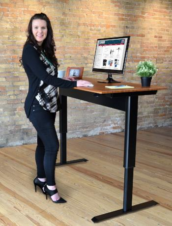 Woman using stand-up desk by Luxor from Active Goods Canada