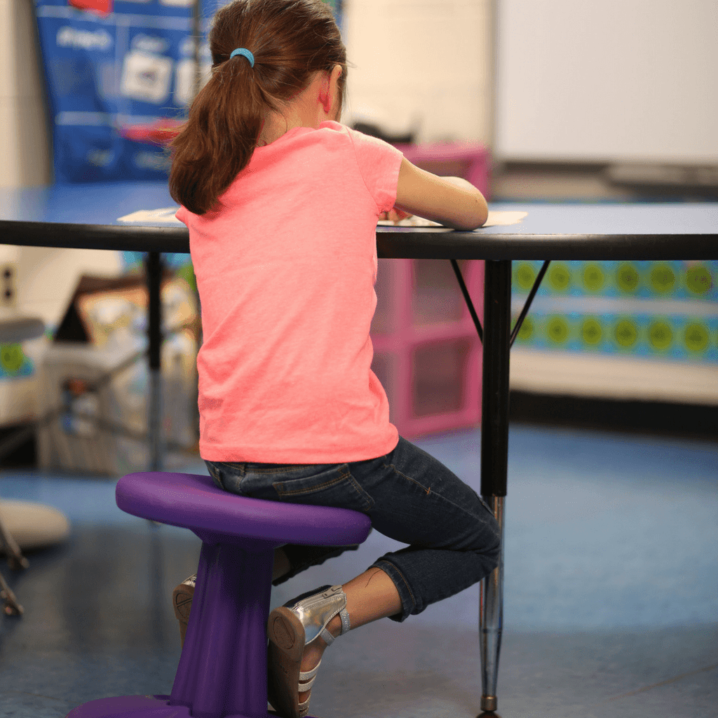"Girl using Kore Kids Wobble Chair 14"" in classroom from Active Goods Canada"