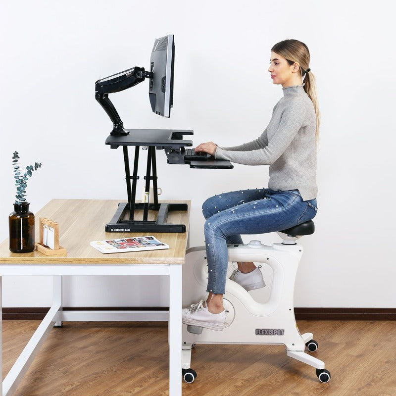 Loctek FlexiSpot Alcove Riser Height Adjustable Desk Converters M7N, M7MB, M7MN, M7C from Active Goods in office with Loctek desk bike from Active Goods Canada