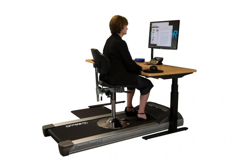 Woman on Tempo TreadTop Office Chair by iMovR with treadmill Fitneff Canada