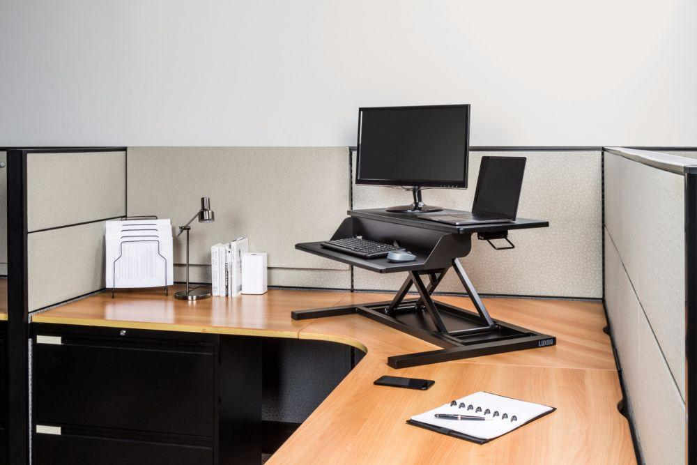 LUXOR height-adjustable standing desk unit in office