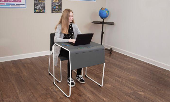 Student using Luxor Lightweight Stackable Student Desk and Chair by Active Goods Canada in classroom