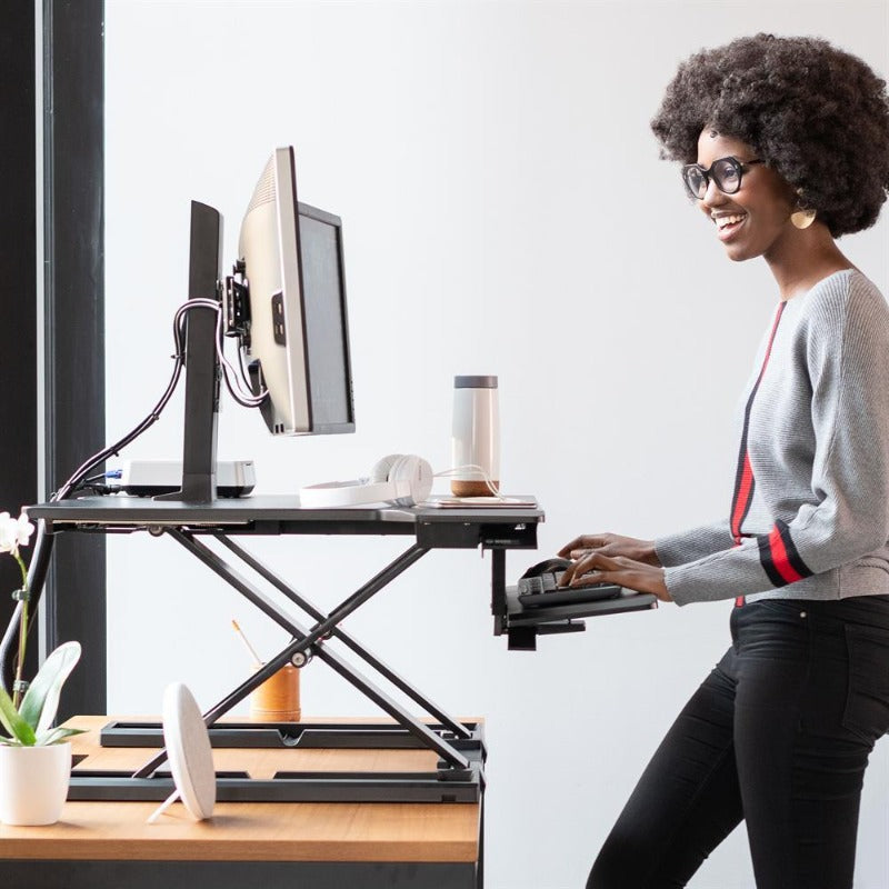 Ergonomic sit-stand height-adjustable desk Ergotron from Active Goods Canada