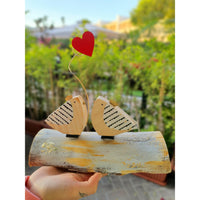 Handmade Wooden Love Birds  on a natural wood log