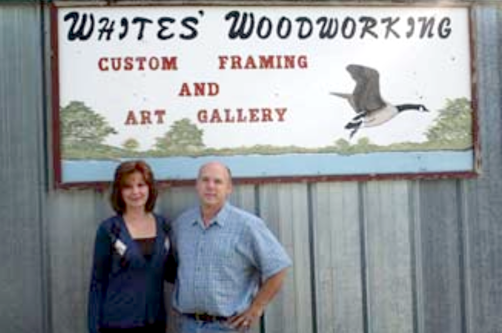 Kim and Dan White in front of Whites' Woodworking and Art Gallery