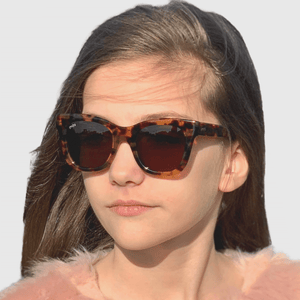 ava wearing mihi kids sunglasses - the hamptons design