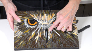 Woman showing a mosaic of an owl