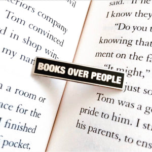 Mini Books Over People Enamel Pin
