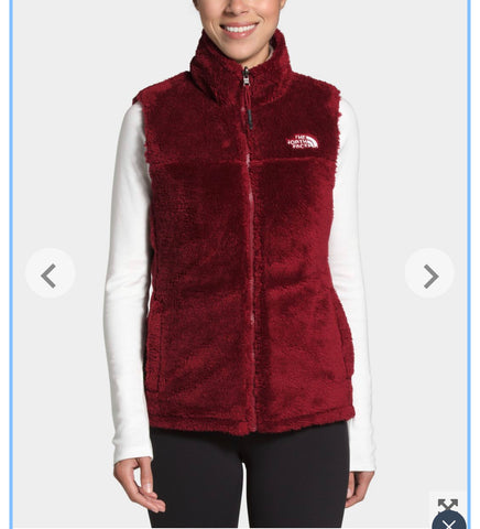 The North Face fuzzy side of reversible vest in pomegranate