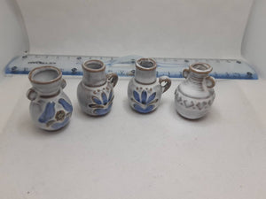 Set of 4 miniature vases