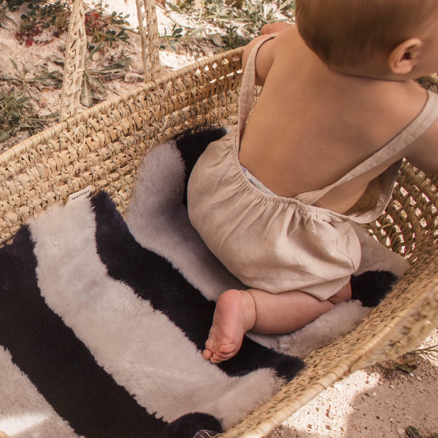 STRIPE SHEEPSKIN SNUGGLER - half moon