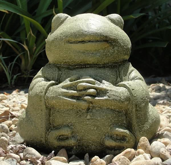 meditating buddha frog stone sculpture