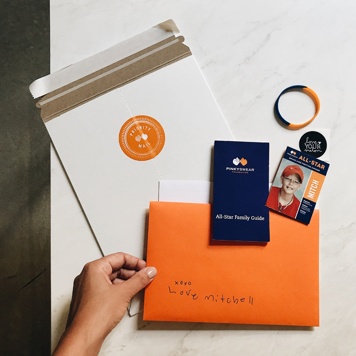 PINKY SWEAR FOUNDATION: THE ORANGE ENVELOPE PROGRAM