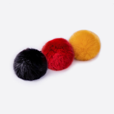 Rusty Yellow, Black, and Red Pom Pack