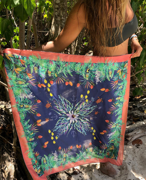 Silk scarf, blue background, coral border. Caribbean scene with palms, donkeys, sugar birds,