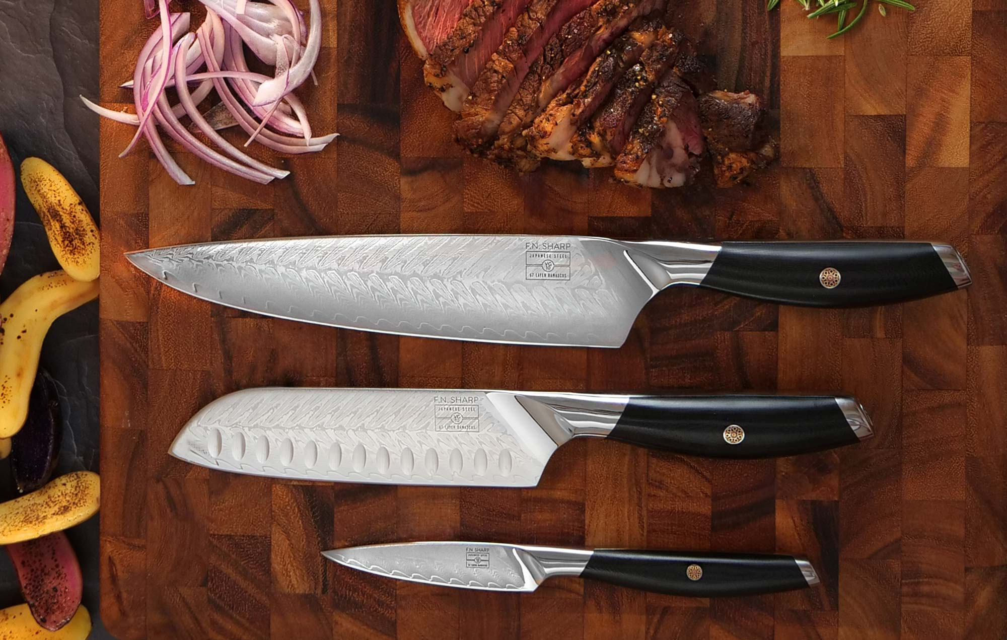 3 Knives on cutting board